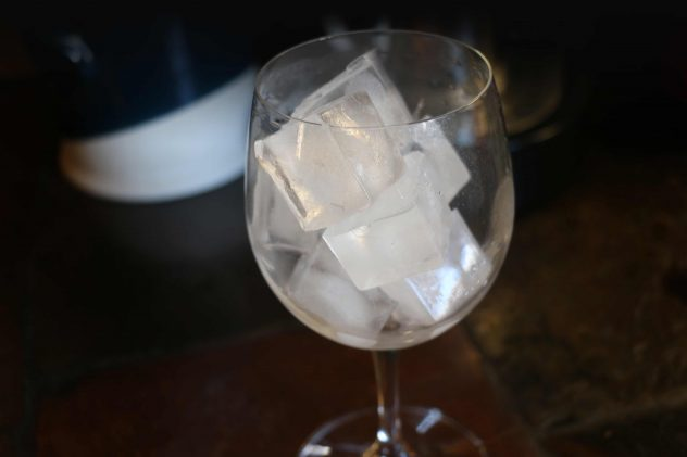 Ice cubes in a wine glass.