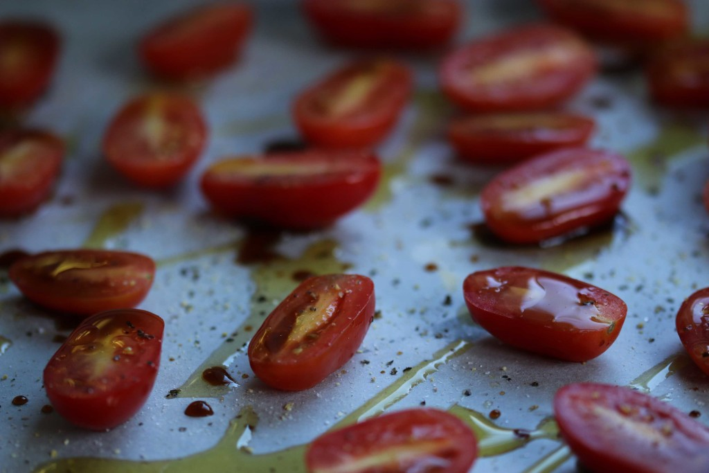 a close up photo of a tray of cherry tomatoes.