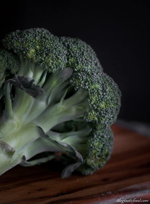 A close up, detailed dark moody photo of broccoli