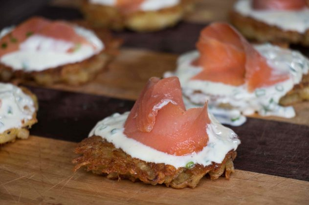 Smoked salmon and sour cream and chive on top of crispy potato cakes.