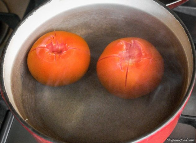 2 tomatoes in a pot of hot water.