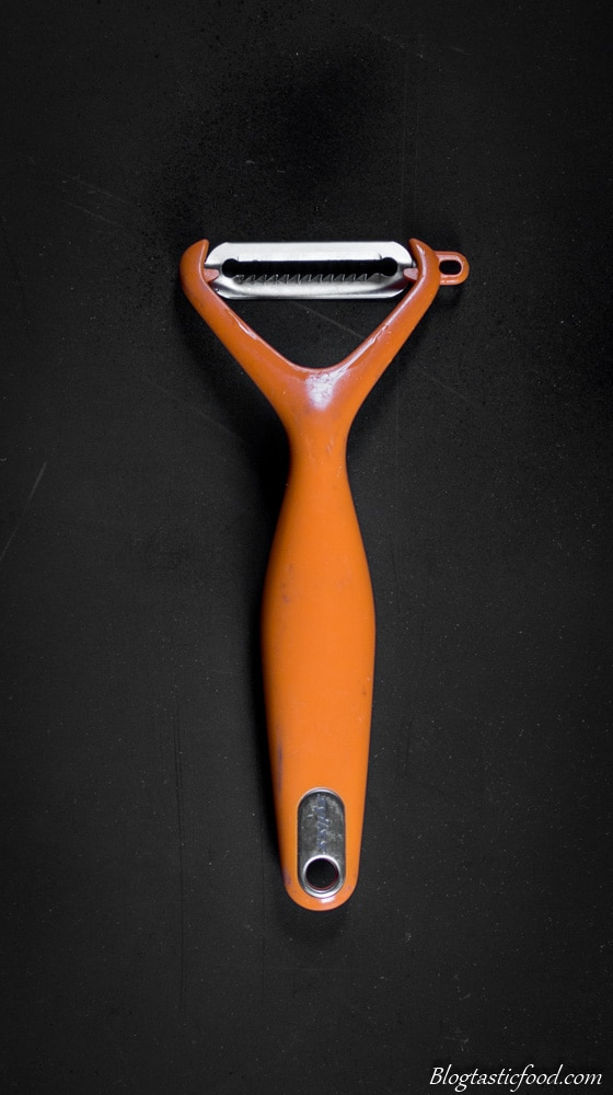 An overhead photo of a julienne speed peeler.