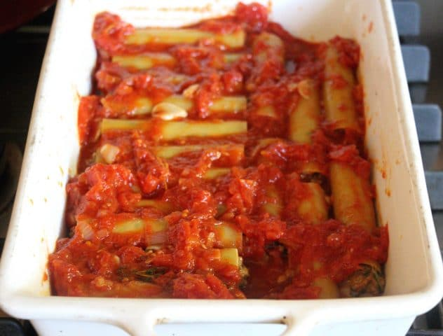 Beef filled cannelloni coated in tomato sauce.