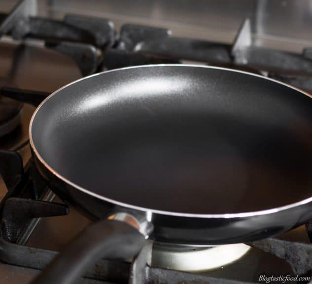A photo is a non-stick pan over a stove.