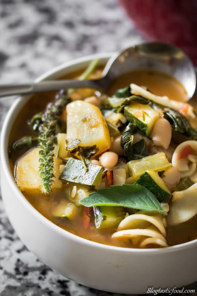 A close up photo of minestrone soup.
