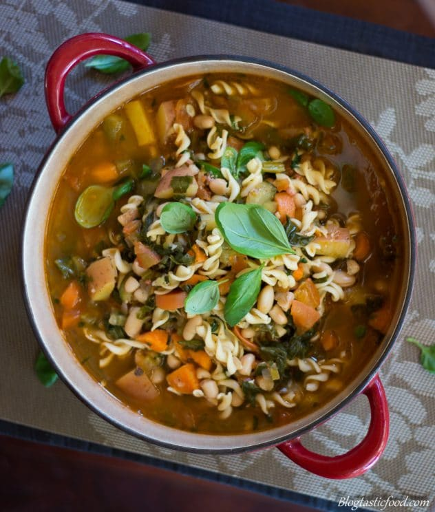 A classic minestrone soup in a large pot.