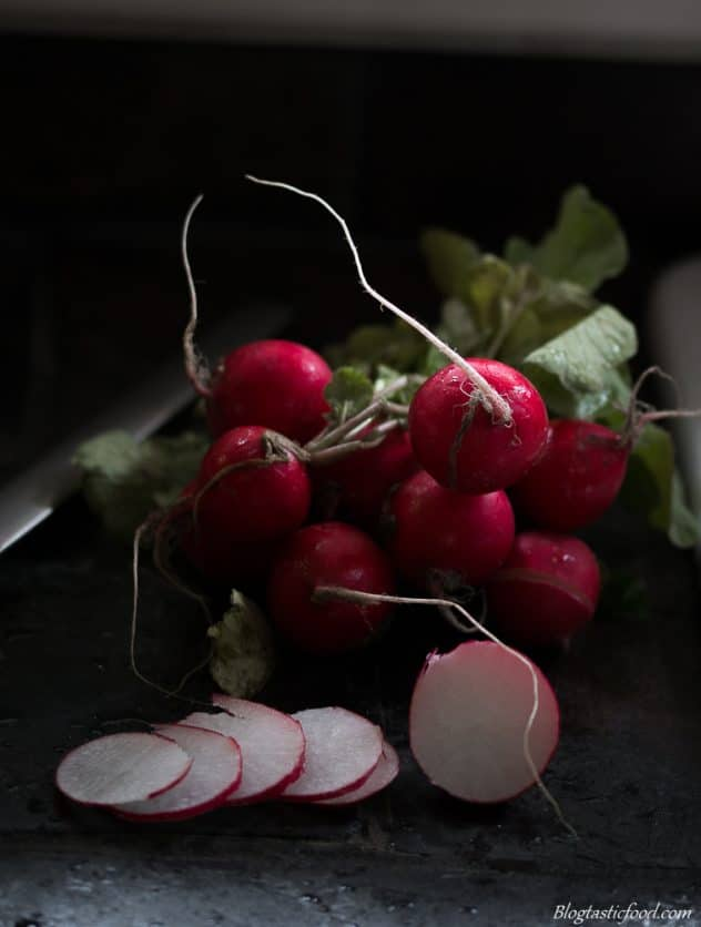 A close up macro photo of a bunch of radishes.