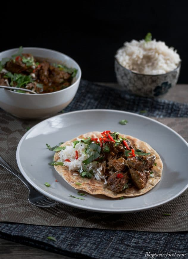 Slow cooker lamb curry served on flatbread.