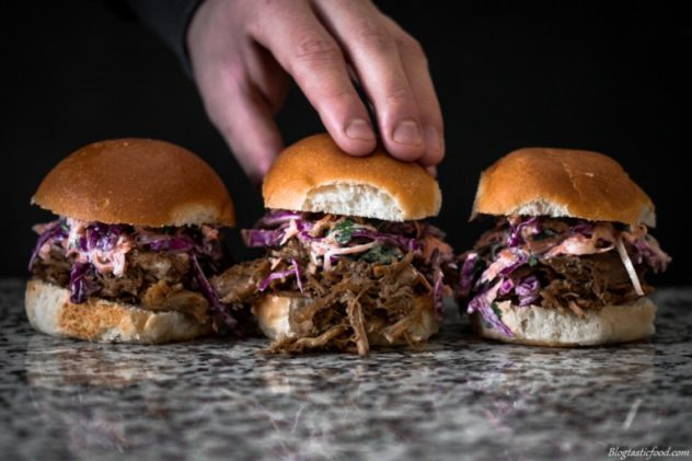 Amazing smokey pulled pork sliders that are also filled with an awesome, fresh, zingy and healthy lemon and yogurt slaw. You are going to love it!