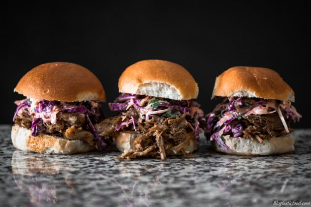 An eye level photo of pulled pork sliders.
