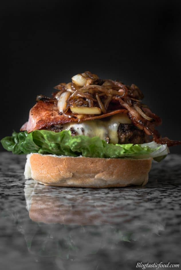 A beef and bacon burger without the top bun.