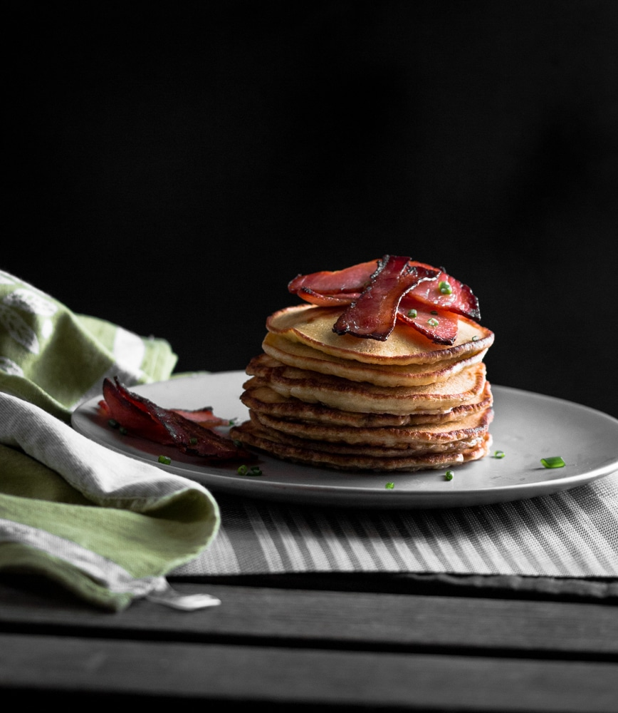 Maple Bacon Pancakes. Super thick and fluffy pancakes with maple syrup glazed crispy bacon. Something to be excited about in the morning.