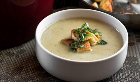 A bowl of Roasted cauliflower and look soup.