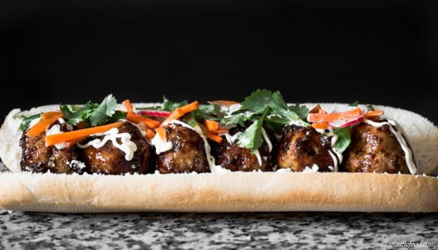 Asian meatballs, kewpie mayonnaise and pickled vegetables in a bread roll.