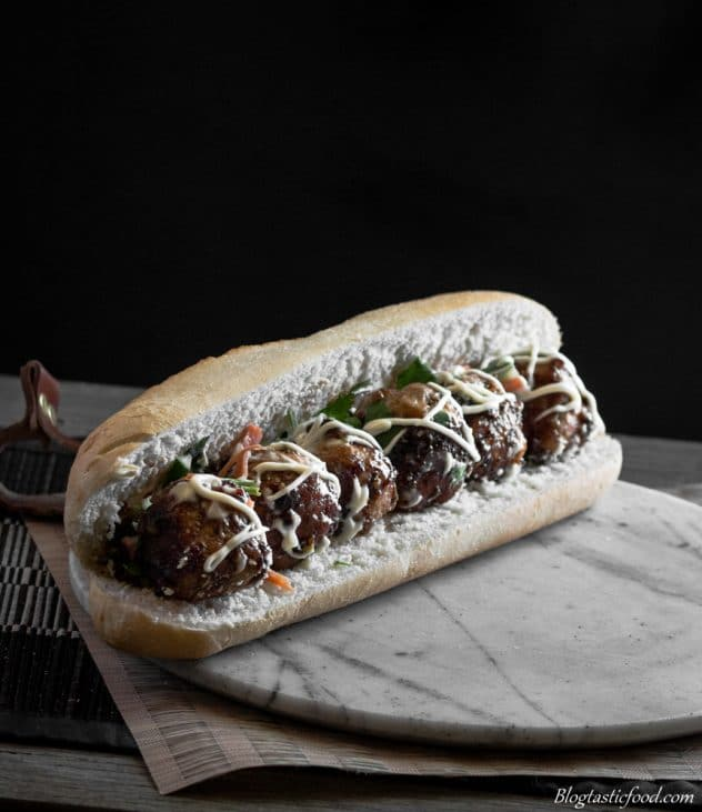 Asian soy glazed meatballs in a sub roll.