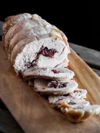 A photo of a cooked brined turkey roll that has been sliced.