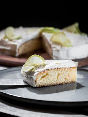 Rosewater cake with citrus butter cream served on a plate.