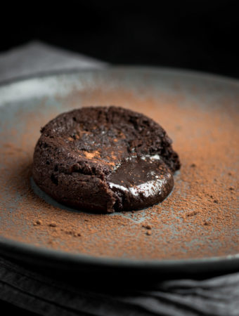 Molten oozing out of a chocolate lava cake.