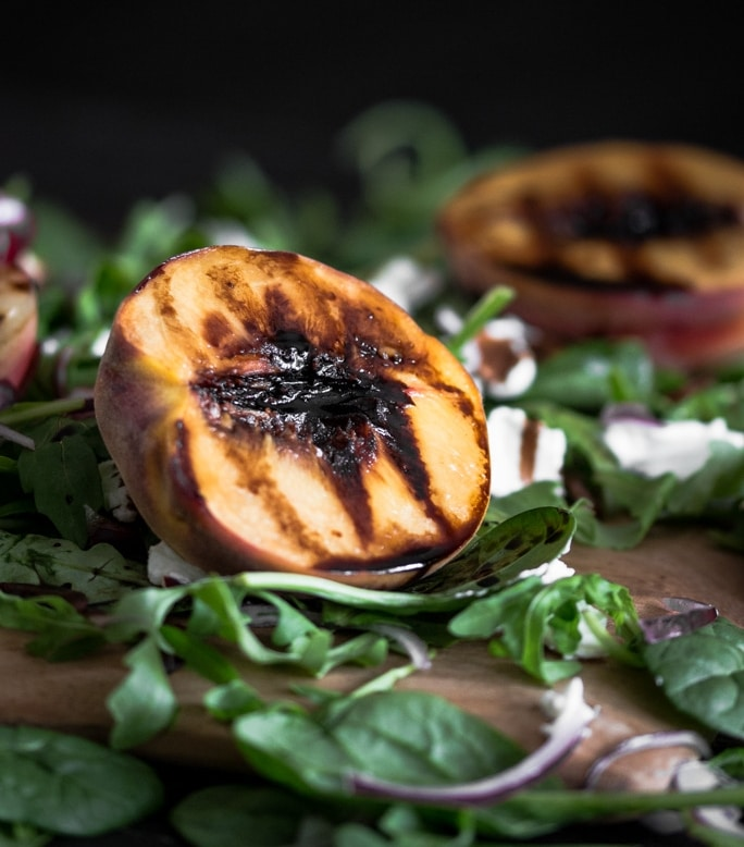Beautiful, vibrant grilled nectarine and peach salad with rocket, spinach, goats cheese, red onion, balsamic glaze and pecans.