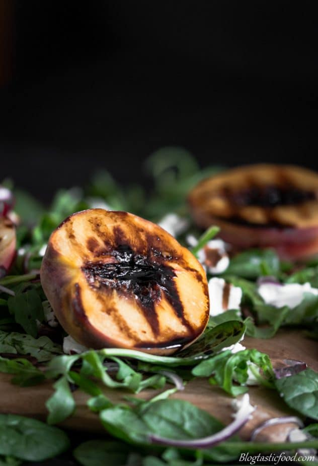 Grilled nectarine and peach salad with rocket, spinach, goats cheese, red onion, balsamic glaze and pecans.