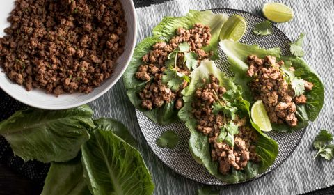 An overhead photo of crispy, spicy beef mince serve in lettuce wraps.