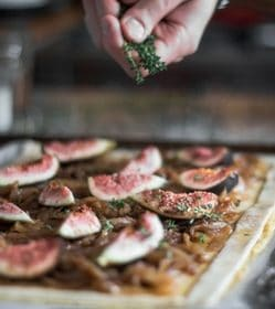 An onion, fig and feta tart recipe presented in the for of a pin for Pinterest.