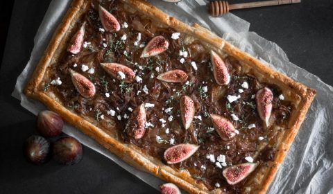 An overhead photo of a fig, onion and feta tart.
