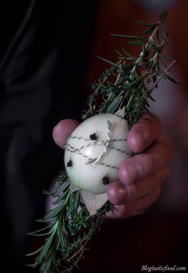 A photo of a bouquet garni (a bundle of aromatics tied up with a piece of string)