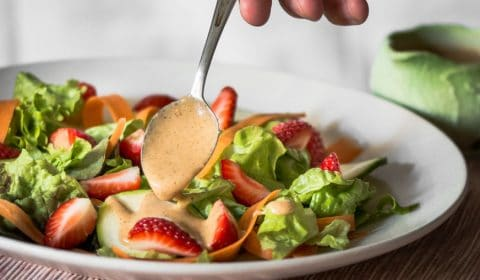 Why not experiment with a basic dressing by adding fruit? This strawberry vinaigrette has a wonderful flavour and the fruit allows the oil to blend in much more easily.