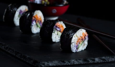These veggie sushi rolls are filled with carrot and red cabbage slaw, made with vegan mayo, cucumber and avocado. Super delicious and super fun to make.