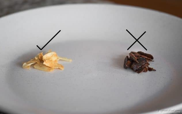 An image showing an example of garlic fried until nice and golden. And another example showing what burnt garlic looks like.