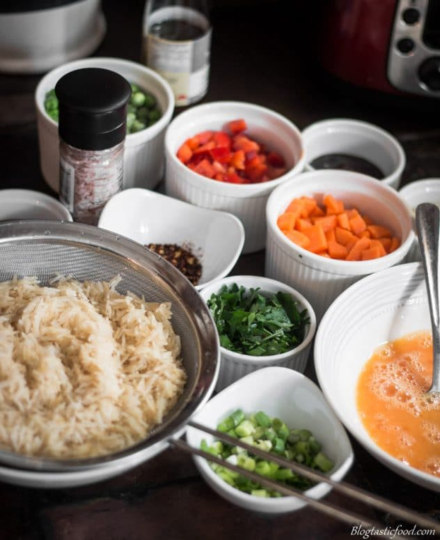 A group of ingredients that are nicely prepared for a fried rice recipe.