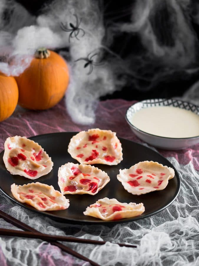 A photo of pumpkin raviolis with fake blood on them.