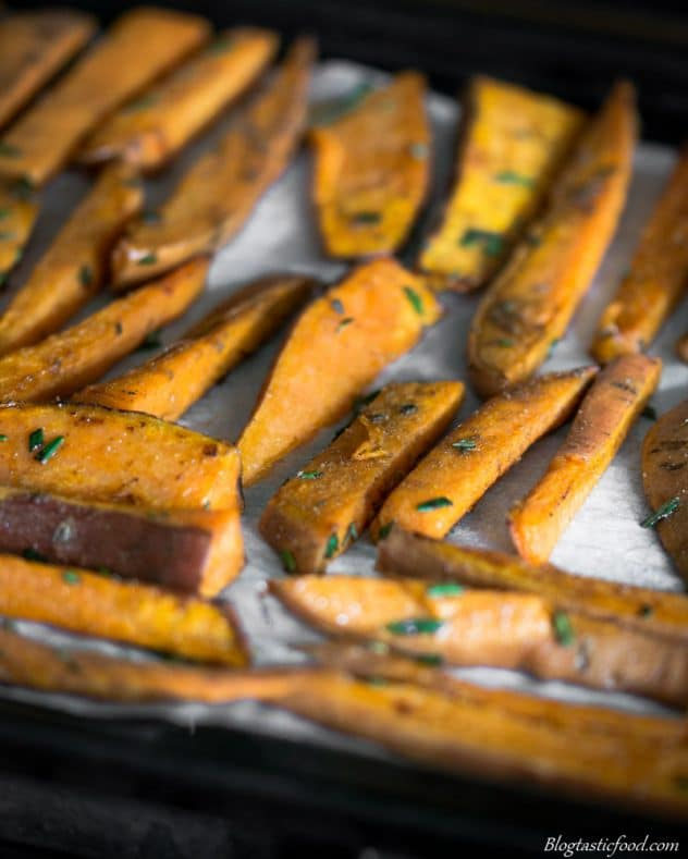 A tray of semi cooked sweet potato wedges ready to go in the oven.