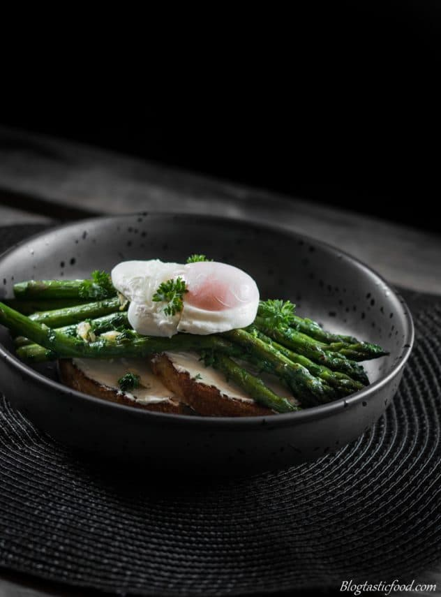 A photo of cream cheese, asparagus and a poached egg on toast.