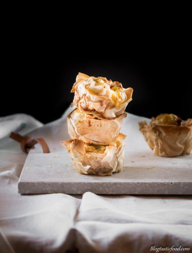 Mini quiches made with filo pastry stacked on top of each other.