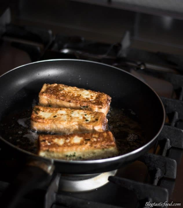 French toast frying in a non-stick pan.