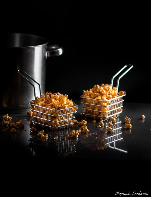 A photo of spiced popcorn served in chip baskets