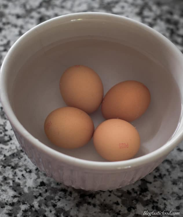 A photo of eggs in a bowl of lukewarm water.
