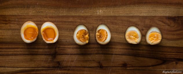 A photo showing the difference of what the inside of a soft boiled, medium boiled and hard boiled ramen egg looks like.