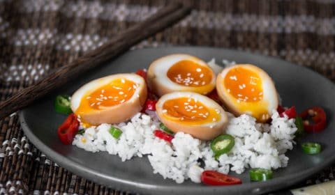 Soft boiled Ramen eggs served on a bed of sushi rice.