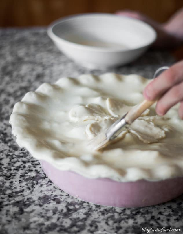 Egg washed being brushed over raw puff pastry.