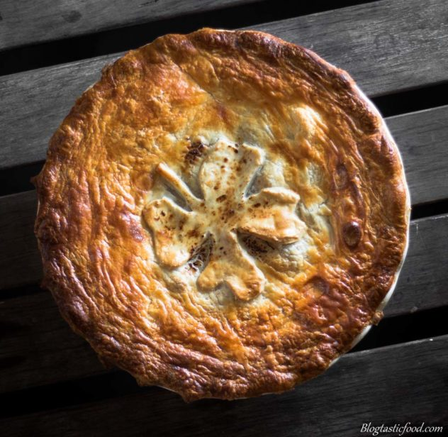 An overhead photo of an Irish stew pie with golden brown puff pastry on top.