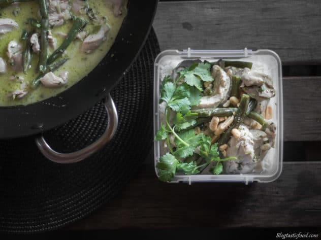 A Thai green chicken curry served in a container.