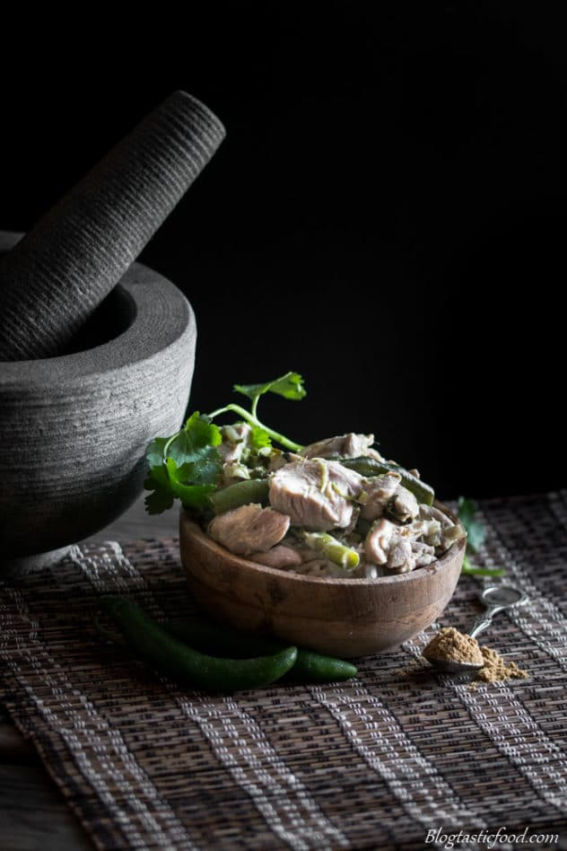 Thai chicken green curry served on a small bowl.
