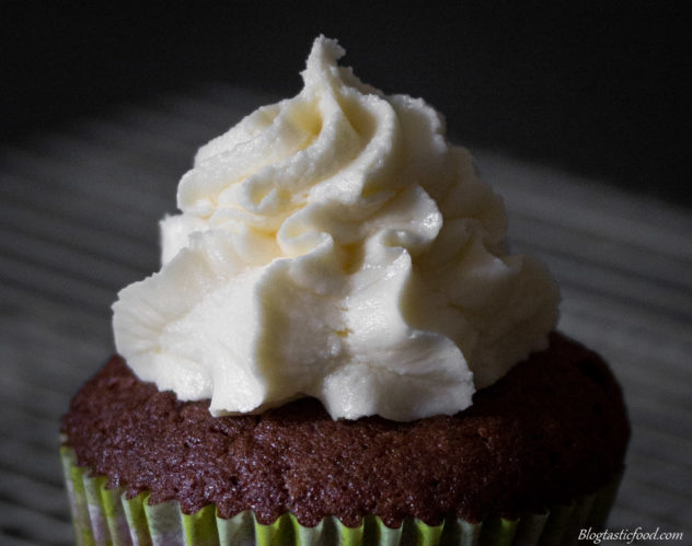 A close up of butter-cream on a cupcake