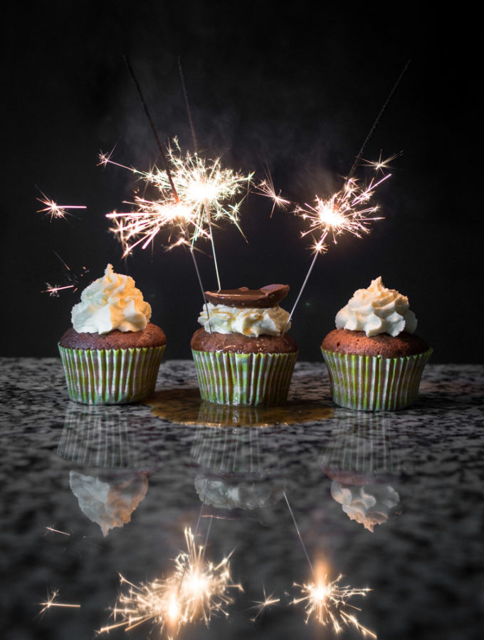 a photo of sparklers lighting up over a group of Easter cupcakes.