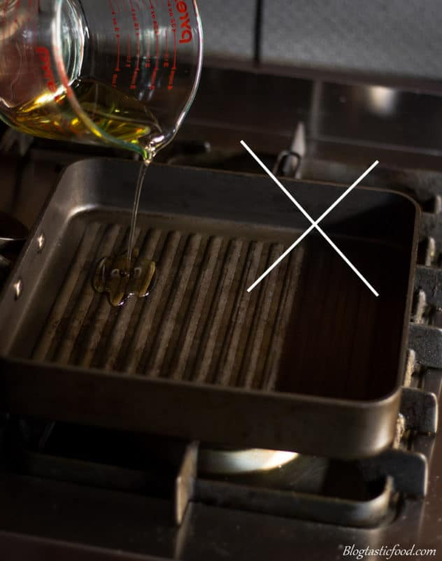 A photo with a cross on it, showing oil being added directly on a griddle pan.