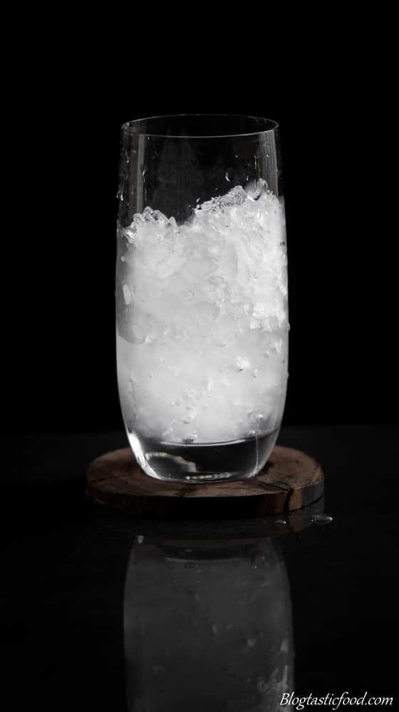A cold glass that has been filled with ice.