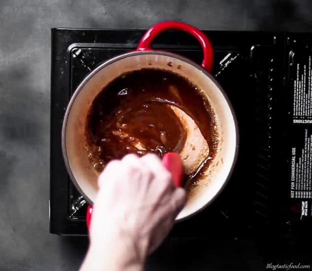 Brown sugar dissolving through melted butter in a pot,